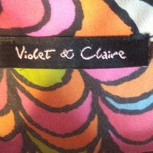 Beautiful unique violet and Claire blouse has larg